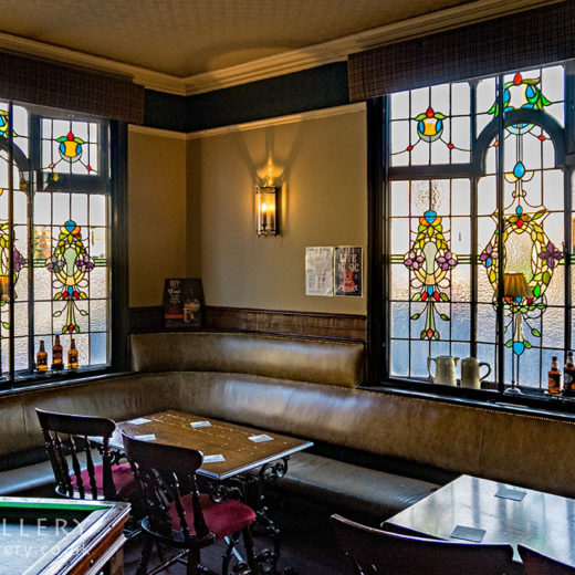 Blossoms, Stockport: Room with stained glass windows