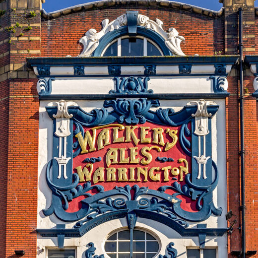 Crown, Liverpool: Close-up of 'Walkers Ales' carved sign