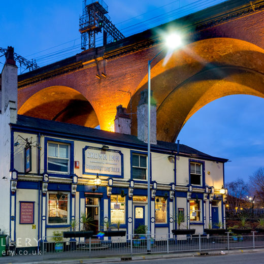 Crown, Stockport: Pub with viaduct behind at night