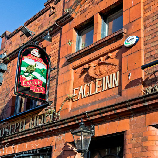 Eagle, Salford: Close-up of carved 'Eagle Inn' sign and inn sign